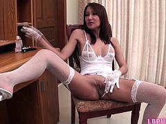 Thai post-op tranny Nam inserts hand into her brand new pussy with hand and fucks herself with a metallic sex-toy. Nam wears sexy set of white lingerie with matching lacy gloves, fishnet stockings and high heels. She is so sexy!