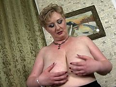 If you like all natural older women, this hefty mature lady is the one for you. She takes off her top to display her saggy fat tits. Watch as she lets them hang low and shakes them back and forth. She would love it if you watched her strip.