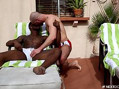 The only difference is Brendan's coffee doesn't have a thick, black cock to go with it! Yeah, Brendan is indeed in an envious position right now. Having a ripped black man with a big dick, and getting to suck on that thing, makes me jealous just looking at it. Rio seems happy with the blowjob as well.