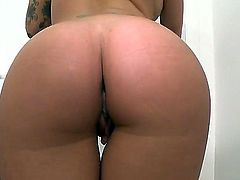 Tattooed totally naked brunette Christy Mack exposes her juicy boobs before she plays with her snatch with legs apart. She fingers her tight pink hole for your viewing pleasure.