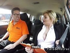 Busty examiner checks instructors work