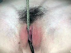 hard rope tears her sensitive pussy