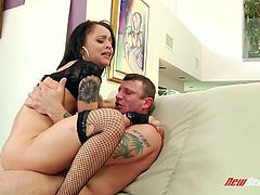 Tattooed hoochie in ripped fishnet stockings Holly Hendrix is fucked by one brutal stud