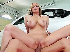 Julia ann makes a young stud fuck her in the garage. This hot blonde milf makes his dick so hard that it could explode if it got any harder. She gets doggy fucked and then she rides him like there is no tomorrow.