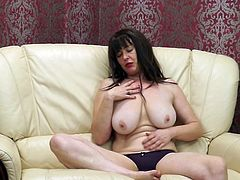 Fantastic brunette with an amazing huge tits and attractive hairy pussy is sitting in front of you... Now the choice is yours. What will you do with this luxurious body? What thoughts are spinning in your head? I think you made the right decision. Act!