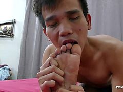 Nishi loves the feet that are in his face, and wants to tickle them. This gets Rizal giggling. Rizal gets revenge and starts tickling Nishis boy feet. The kinky foot tickle play is getting these gay Asian twinks horny for some male foot worship. The boys start sucking toes and licking soles. One thing leads to another as the boys start kissing and sucking cock. More gay male feet fetish ensues and now the boys want to fuck bareback. Rizal gets between Nishis legs and enters. Nishi gives him th