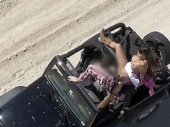 Busty Mercedes Carrera gets in a jeep and takes off her top. She then gets driven around the beach with the hot sun tanning her tight body. She then humps the driver.