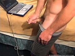Straight boy Brock is a tough and masculine guy, with a ripped muscular body. With the laptop playing a porn video, he places it exactly where he wants it, pushes his shorts down and starts stroking. Apparently a bit camera shy, it takes him a while to get his cock hard, but eventually succeeds. With the erotic sounds of fucking coming from the laptop, Brock pumps out a couple of ropey projectiles, about 3 feet, making a trail back to his feet. And if that isnt enough, a few minutes later he sh