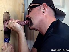 It was a beautiful afternoon when this daddy man stops by to feed me his cock at the gloryhole. Once I had that meat in my mouth it didnt take me long to get it stiff and blow on my lips.