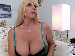 They dress up in lingerie for a night of hot fucking, and the blonde mature with great big boobs makes her little brunette friend suck on her big strapon dick until its nice and wet. Then she fucks her friend hard from all angles