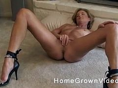 Blonde babe takes off her panties for a hot masturbation game