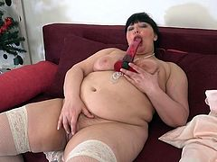 Just take a look at our Arina and it will be impossible for you to hold your dick in your pants any longer. She looks so tempting and inviting in those white stockings, and with her red jelly dildo between her huge tits... Join and enjoy! Juicy bbw mature masturbates just for you!