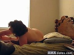 A dark haired bbw mature gets pounded from behind by a muscular dude in front of a camera.