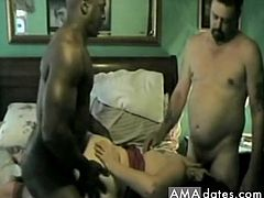 A horny amateur brunette wife isn't anymore satisfied with her husband's cock and they invited a muscled black guy so that the sexy wife enjoys to suck the big dick of her husband while her black lover fucks her hard from behind.