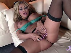 Lovely model Claudia Valentine wears stockings while masturbating