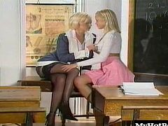 Kelle Marie and Monica Sweet are fellow teachers who are in the blonde teachers classroom, going over their homework assignments, when the one lesbian reaches over and begins feeling up the other blondes stocking covered leg.