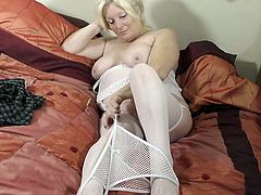 Cindy is one of the most beautiful mature women you have ever seen. Just look at this blonde goddess as she plays with her vibrator. It's absolutely breathtaking to watch her play with her gigantic tits and her moist, mature pussy. This lady craves for cock willing to fulfill her desires.