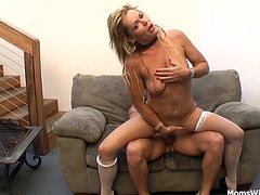 Kelly Leigh is sexy in her bra and panties in white stockings. Bends over sucking cock revealing her pussy. Gets fucked fucked hardcore and get a warm cum shot.