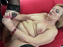 She hungrily nurses on her neighbors stiff ebony rod, fingering her love button while she sucks. Parting her fleshy thighs, she surrounds him with jiggly poon, and holds on tight while his prong works up to a hot eruption that coats her puffy white belly with sperm.