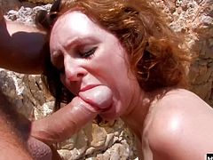 Super sexy redhead Leane Fontaine is in the mood for fun but not the frisbee kind. She wants some hard fucking at the beach, and the two surfer dudes available are just the thing to make her even hotter Stripping out of her string bikini, Leane gets fucked and double stuffed, then slicked up with two loads of cum to help her pale skin get some color in the sun