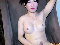 Thai ladyboy on a cosplay collegegirl outfit with a short plaid skirt strips and settles herself down on the arm-chair for jerking off for lucky guy. Later she will start to give him and blowjob, but his girlfriend gets back home.