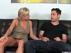 Young guys got car keys so to get them and to keep her outing a secret she strokes his cock until he releases a big load all over her.