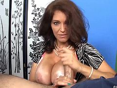 She talks to you while displaying her massive boobs wraps her hands on your cock and wants you to cum on her tits.