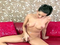 Eurobabe fingers and toys her shaved pussy with her cockring vibrator and big black dildo which makes her have a gsport orgasm and squirt all over her sexy wet body