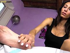 Barefoot brunette cream foot massage