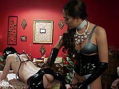 This miserable sex slave in black latex mask sensually licks the brunette tranny's asshole, even without trying to refuse, but quite the contrary, enjoying this strange, but nonetheless sexual game.