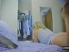 It is never boring to spy my mother in her bedroom. Fingering underneat her panties after having browsed in a magazine.