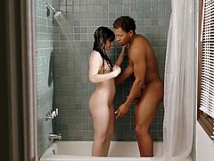 Alluring slender babe Karly Baker is fucked by horny black guy in the bathroom