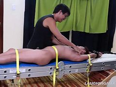 He is delightfully ticklish, and his boy feet are to die for. We have him strapped down on the Laughing Asians tickle rack for sexy straight boy Willy to have his way with. Then Ricky steps in and tickles the hell out of him until hes tickled pink.