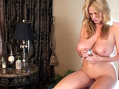 Kelly Madison makes her pussy wet with a nice sex toy