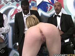 Lily Labeau offers her cock sucking talent for a gang of black guys. She slurped on all the big black cocks shoved into her face. She was gagging, spitting, jerking and choking...
