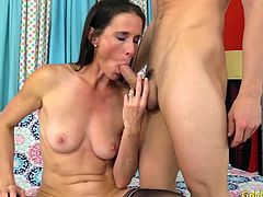 Sexy brunette Mature woman gets naked and shows her tits and pussy She rub and fingers her pussy Then sucks a stiff cock and then gets her pussy pounded hard with it
