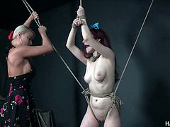 Slutty chick London River is punishes in the BDSM room