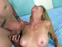 Sexy mature slut gets her tits sucked and she gives a nice blowjob Then gives a nice tits fuck Later she gets her pussy reamed hard in many positions The guy spills cum over her tits