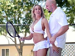 Captivating milf with sexy tan lines Brandi Love gives a blowjob on the tennis court