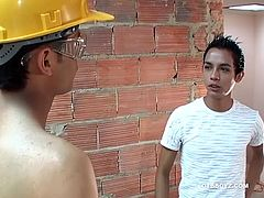 Manuel spots a shirtless young construction worker busy at his job and hopes he can intice the gorgeous boy to fuck his Latin ass. Alfredo can see what the boy wants and makes it clear hes up for a break from his labors. The two make out, as their clothes peel off and little Manuel soon finds himself on the receiving end of a blowjob. Then he goes down on Alfredos big uncut cock, before bending over to take it from behind. The skinny and smooth twinks fuck in a variety of positions, until Manu
