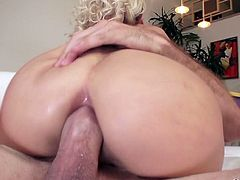 Curvy blond chick Marsha May takes a dick in her stretched anus