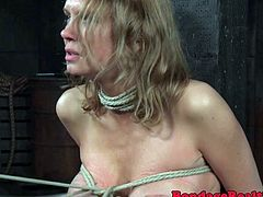 Crucified milf with big tits gets disciplined