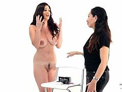 A naked girl interviewing a clothed girl