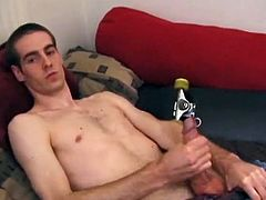 Theres some good porn playing on the TV, so James Shafer decides to jack off. He pulls out his pierced dick and strokes it with determination, until he blows his warm cum load all over his chest.