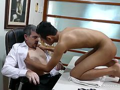 Joshua is under-qualified for the job, but the boss is willing to make some sexual concessions. This sexy gay Asian boy is willing to do anything to get his foot in the door, even if it means getting the boss cock up his twink ass. Joshua shows Daddy Mike just how eager he is to please by offering Daddy a blowjob. But thats just the beginning as daddy wants to bareback fuck this Asian twink. After a satisfying gay sex session, Daddy Mike rewards the eager twink with the job.