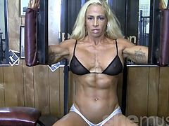 Blonde Sexy Female Bodybuilder in See Through Top Works Out