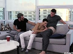 Looks like these horny gay men decided to show this inexperienced guy how real gay love feels like... While he sucks on his neighbour's fat dick, another guy penetrates his tight virgin asshole. Rough threesome on the couch!