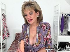 Watching this video you will truly feel as if Lady Sonia is grabbing onto your cock and jerking you off. The way she looks into the camera and makes that dildo cum will make you feel as if you're right there with her.