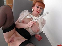 Redheaded whore in her red bottom shoes finds an empty office and puts on a show by the window in a highrise. She gets so wet she cant resist shoving her glass dildo up her red cunt.