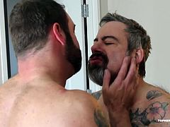 Daddy Zev returns for this wet and wild bareback and piss scene with Topher Phoenix. Its been a while and Zev is ready to open up Tophers tight hole. Then he decides, its better to mark his piglet with a golden shower, before getting down to the dirty work. After some pissing play Daddy fucks Tophers ass in a variety of positions, before Topher lets Zev have it from the tap. It all ends with a shot of Tophers gaping wrecked hole.